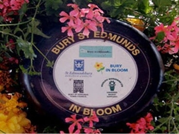 Sponsors listed on base on hanging baskets for Bury In Bloom.